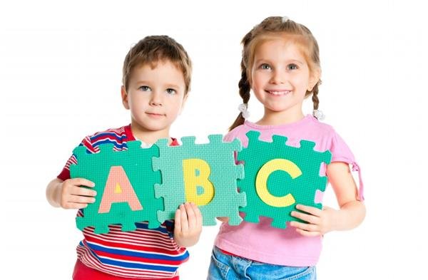 Children holding alphabet letters