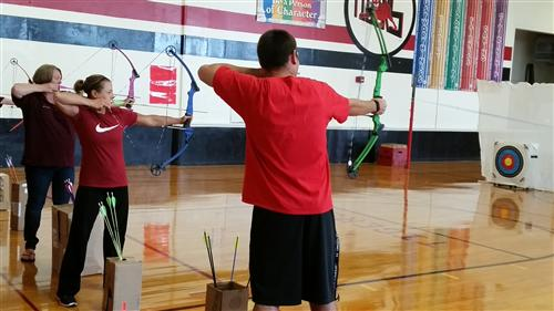 Teachers shooting arrows