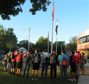 Students gather around the Pole